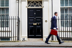 © licensed to London News Pictures. London, UK 18/03/2015. Chancellor of the Exchequer George Osborne posing for photographers outside 11 Downing Street before presenting his annual budget to Parliament on Wednesday, 18 March 2015. Photo credit: Tolga Akmen/LNP