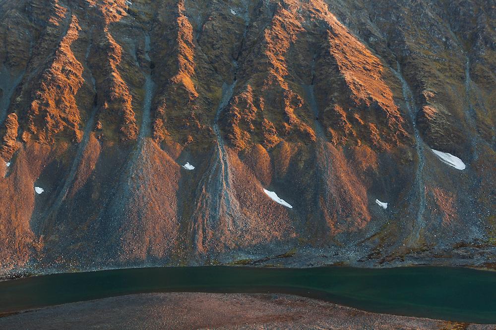 Myrktjorna at the base of the eroding slopes of Gullichsenfjellet near the Polish research station of Baranowka, Svalbard.