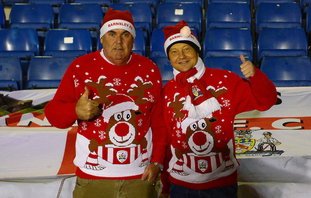Barnsley fans wear Christmas Sweaters as the match is played after being postponed on Boxing Day.<br /> <br /> Photographer Richard Martin-Roberts/CameraSport<br /> <br /> Football - The Football League Sky Bet League One - Bury v Barnsley - Tuesday 23rd February 2016 - Gigg Lane - Bury  <br /> <br /> © CameraSport - 43 Linden Ave. Countesthorpe. Leicester. England. LE8 5PG - Tel: +44 (0) 116 277 4147 - admin@camerasport.com - www.camerasport.com