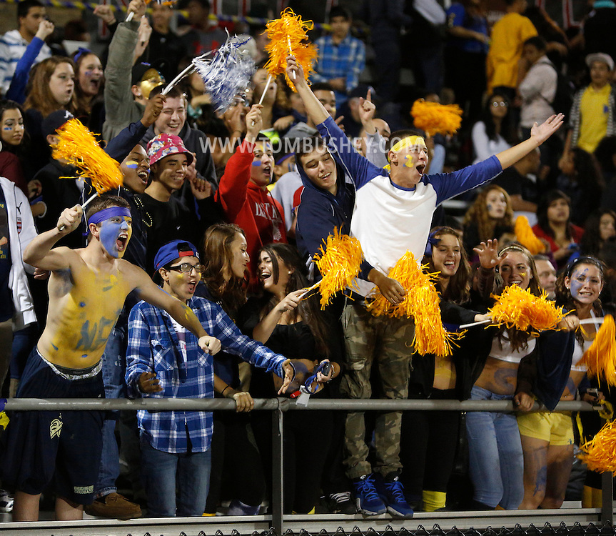 Newburgh Free Academy football fans cheer for their team during a game against Pine Bush on Friday, Oct. 11, 2013.