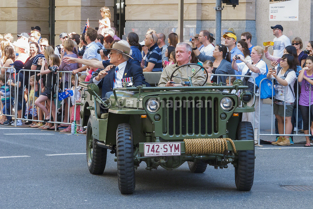 Veterans in jeep in Brisbane 2013 ANZAC day parade <br /> <br /> Editions:- Open Edition Print / Stock Image