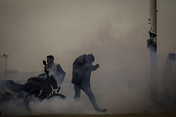 March 29, 2019 - Gaza City, The Gaza Strip, Palestine - Palestinian protesters run from tear gas east of Gaza city during friday clashes, Palestinians were shot and injured by Israeli live fire in weekly protests (Credit Image: © Abed Alrahman Alkahlout/Quds Net News via ZUMA Wire)
