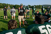 St. Johnsbury head coach Rich Alercio talks to the players during the boys football scrimmage game between the St. Johnsbury Hilltoppers and the Mount Mansfield Cougars at MMU high school on Friday afternoon August 24, 2018 in Jericho. (BRIAN JENKINS/for the FREE PRESS)