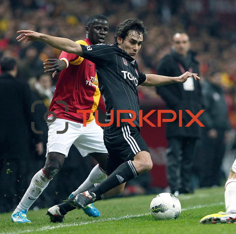 Besiktas's Veli Kavlak (R) Action picture during their Turkish superleague soccer derby match Galatasaray between Besiktas at the TT Arena at Seyrantepe in Istanbul Turkey on Sunday, 26 February 2012. Photo by TURKPIX