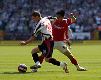 Photo: Olly Greenwood.<br />Charlton Athletic v Sheffield United. The Barclays Premiership. 21/04/2007. Charlton's Zheng Zhi can't tackle Sheffield United's Nick Montgomery