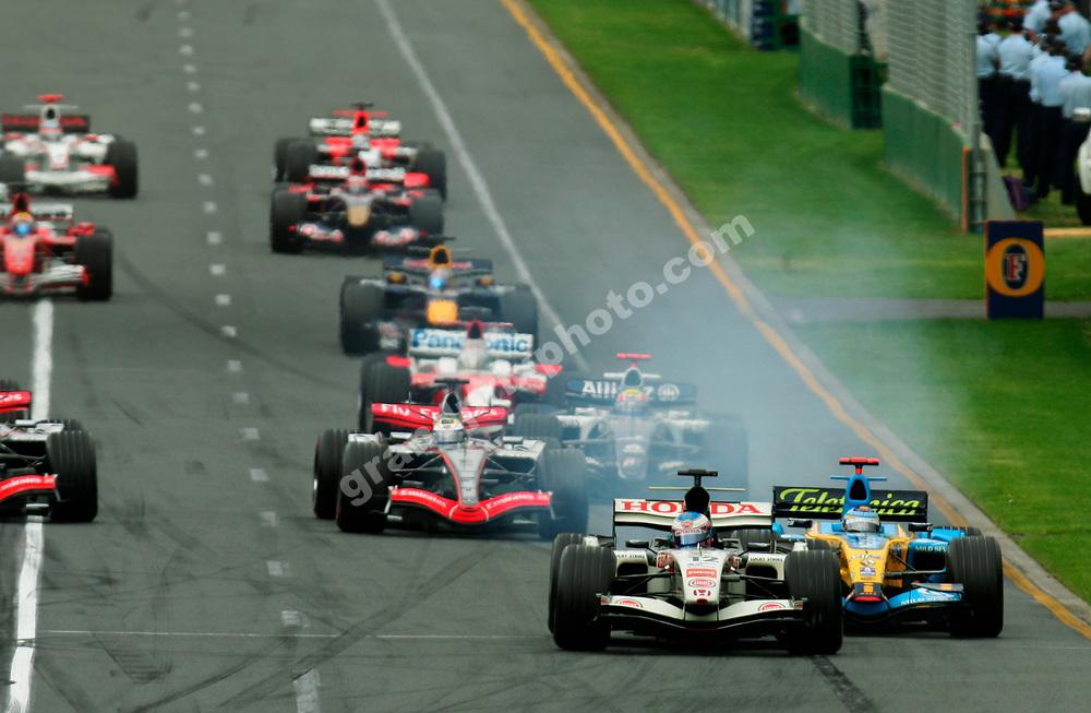 Jenson Button (Honda) leading Fernando Alonso (Renault) into the first corner of the 2006 Australian Grand Prix in Albert Park, Melbourne. Photo: Grand Prix Photo
