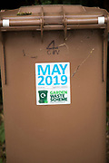 May 2019 date sticker on garden waste scheme brown compost collection bin, East Suffolk, England, UK