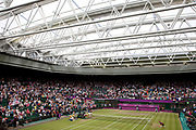 Crowds watch in Centre Court as the Tennis events at the London 2012 Olympics take place at Wimbledon. Closed roof.