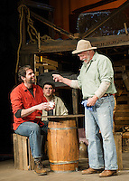 "Slim (Matt McGonagle) and The Boss (Dand Gardner) with Lennie Small (Michael G. Baker) listening behind during dress rehearsal for ""Of Mice and Men"" at the Winnipesaukee Playhouse on Tuesday evening.  (Karen Bobotas/for the Laconia Daily Sun)"