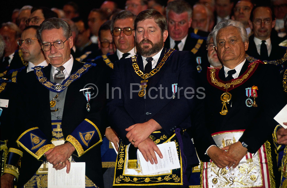 Assembled Freemasons offer prayers during a  masonic ceremony at Earls Court, London..Freemasonry, which traces it's modern origins back to the sixteenth century is beased on principles of fraternity and secrecy. Members are sworn to keep silent on their activities and make themselves known to other Freemason's by way of signal (often a handshake).