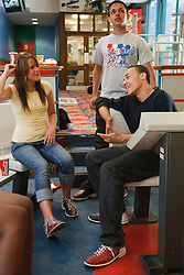 Teenage group at bowling alley.