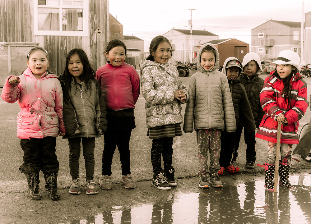 A group of children who are happy to look at my camera. There is a lot of children playing outside all year round, in Inukjuak.
