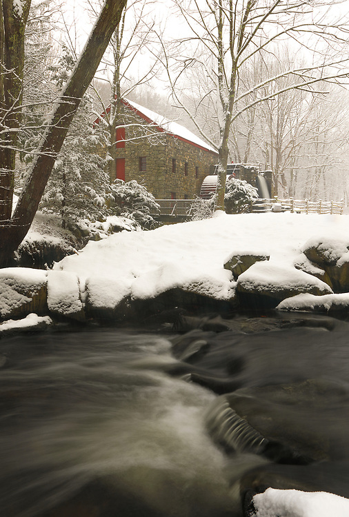 The Wayside Inn Grist Mill in Sudbury Massachusetts during a New England snowstorm in winter. A long exposure photography setting conveys the flowing water of the brook in the front and the falling waters across the Grist Mill.<br /> <br /> Sudbury Grist Mill winter photography images are available as museum quality photo, canvas, acrylic, wood or metal prints. Wall art prints may be framed and matted to the individual liking and interior design decoration needs:<br /> <br /> https://juergen-roth.pixels.com/featured/sudbury-grist-mill-winter-juergen-roth.html<br /> <br /> Good light and happy photo making!<br /> <br /> My best,<br /> <br /> Juergen<br /> Licensing: http://www.rothgalleries.com<br /> Photo Prints: http://fineartamerica.com/profiles/juergen-roth.html<br /> Photo Blog: http://whereintheworldisjuergen.blogspot.com<br /> Instagram: https://www.instagram.com/rothgalleries<br /> Twitter: https://twitter.com/naturefineart<br /> Facebook: https://www.facebook.com/naturefineart