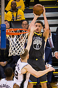 Golden State Warriors guard Klay Thompson (11) shoots a jumper against the San Antonio Spurs during Game 2 of the Western Conference Quarterfinals at Oracle Arena in Oakland, Calif., on April 16, 2018. (Stan Olszewski/Special to S.F. Examiner)