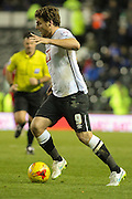 Derby County forward Chris Martin head for goal during the Sky Bet Championship match between Derby County and Cardiff City at the iPro Stadium, Derby, England on 21 November 2015. Photo by Aaron Lupton.