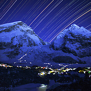 Star trails arc across the night sky above Khubu Basecamp on Mount Everest, Nepal.