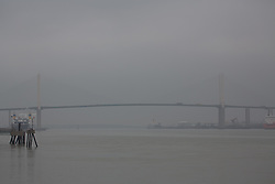 © Licensed to London News Pictures. 20/09/2014. With low visibility on a miserable, murky day, many drivers were forced to use their headlights in the middle of the day. There were tail backs and slow moving traffic at the QEII Bridge at Dartford. Credit : Rob Powell/LNP
