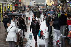 Glasgow, Scotland, UK. 20 November 2020. On the day when the severest level 4 lockdown will be imposed at 6pm, shoppers are out on the streets of Glasgow doing last minute Christmas shopping before the shops close for 3 weeks. Pictured;  Shoppers on Argyle Street. Iain Masterton/Alamy Live News