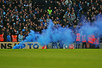 Football - 2017 / 2018 FA Cup - Fifth Round : Brighton and Hove Albion vs. Coventry City<br /> <br /> Coventry fans throw a flare onto the pitch after there side scored at The Amex Stadium Brighton <br /> <br /> COLORSPORT/SHAUN BOGGUST