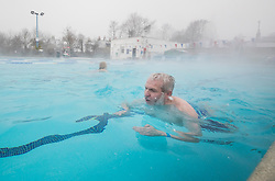 © Licensed to London News Pictures. 02/03/2018. London, UK. Swimmers brave the cold and snow at Hampton heated outdoor pool in south west London. The 'Beast from the East' and Storm Emma have brought extreme cold, ice and heavy snow to the UK. Photo credit: Peter Macdiarmid/LNP