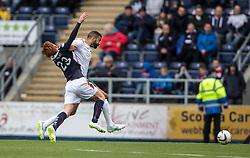 Falkirk's Scott Shepherd held by Hibernian's Liam Fontaine. <br /> Falkirk 0 v 3 Hibernian, Scottish Championship game played at The Falkirk Stadium 2/5/2015.