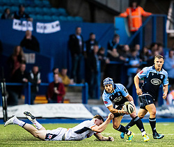 Matthew Morgan of Cardiff Blues evades the tackle of George Taylor of Edinburgh Rugby<br /> <br /> Photographer Simon King/Replay Images<br /> <br /> Guinness PRO14 Round 2 - Cardiff Blues v Edinburgh - Saturday 5th October 2019 -Cardiff Arms Park - Cardiff<br /> <br /> World Copyright © Replay Images . All rights reserved. info@replayimages.co.uk - http://replayimages.co.uk