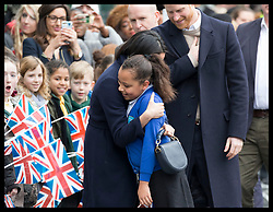 March 8, 2018 - Birmingham, United Kingdom - Image licensed to i-Images Picture Agency. 08/03/2018. Birmingham , United Kingdom. Meghan Markle hugs a child during a walkabout at an event to celebrate International Women's Day at Millennium Point in Birmingham, United Kingdom. (Credit Image: © Stephen Lock/i-Images via ZUMA Press)