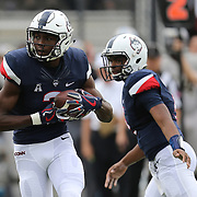 ORLANDO, FL - NOVEMBER 11: Tyraiq Beals #2 of the Connecticut Huskies runs with the ball after a handoff by David Pindell #5 of the Connecticut Huskies during a NCAA football game between the University of Connecticut Huskies and the UCF Knights on November 11, 2017 in Orlando, Florida. (Photo by Alex Menendez/Getty Images) *** Local Caption *** Tyraiq Beals; David Pindell