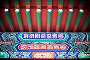 Some colourful Tibetan decorations and drawings are seen on a wooden panel at the Yonghe Temple (Chinese 雍和宮, pinyin Yōng hé gōng), also known as the Lama Temple in Beijing, China, August 15, 2014.<br /> <br /> Confucianism, Taoism and Buddhism are the three major religions in China. Temples and statues witness their ancient roots all over the Chinese country.<br /> <br /> © Giorgio Perottino