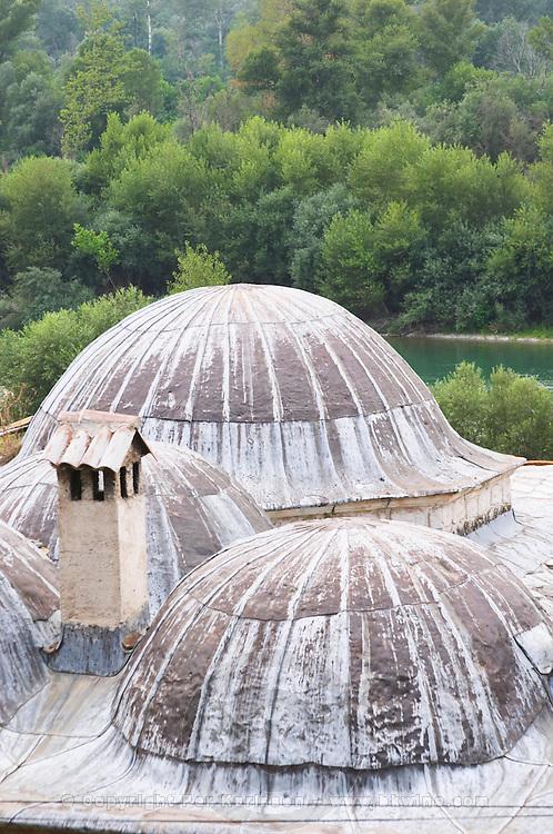 Roof top with domes and chimney. Pocitelj historic Muslim and Christian village near Mostar. Federation Bosne i Hercegovine. Bosnia Herzegovina, Europe.