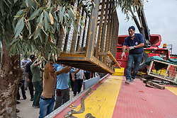 March 30, 2017 - Mosul, Nineveh Province, Iraq - Accompanied by DR. KHALIL, LULA is moved by crane to a flatbed truck during the evacuation. A lion and a bear, just rescued from Mosul's zoo, are prepared to fly to safety outside Iraq and into Erbil, Kurdistan. The two animals nearly starved to death in their cages while battle raged around them in the Iraqi city earlier this year. Several other animals at the zoo died from neglect but these two were finally rescued by the animal charity Four Paws. (Credit Image: © Gabriel Romero via ZUMA Wire)