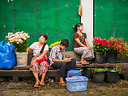 02 NOVEMBER 2014 - YANGON, MYANMAR: Flower vendors in the 38th Street morning market in downtown Yangon, Myanmar. The market is typical of morning markets in Yangon, a city coming out of more the 50 years of economic isolation. Most people still shop in markets because Yangon does not have as many grocery stores as Bangkok, Kuala Lumpur or many other large cities.     PHOTO BY JACK KURTZ