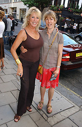 Left to right, PATTI BOYD and her sister JENNY BOYD at an exhibition of photographs by David Montgomery entitled 'Shutterbug' held at Scream, 34 Bruton Street, London W1 on 13th July 2006.<br /><br />NON EXCLUSIVE - WORLD RIGHTS