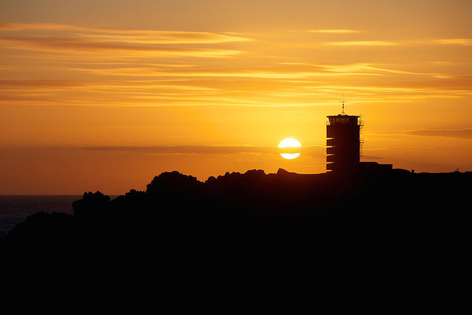 Silhouette of the Radio Tower, Heritage property and accommodation, against the orange sky st sunset in Jdersey, C.I.