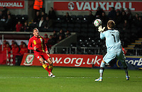 Pictured: Robert Almer, goalkeeper for Austria saves the ball (R), threatened by Craig Bellamy of Wales (R). Wednesday 06 February 2013..Re: Vauxhall International Friendly, Wales v Austria at the Liberty Stadium, Swansea, south Wales.