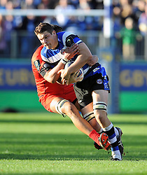 Charlie Ewels of Bath Rugby takes on the Toulouse defence - Photo mandatory by-line: Patrick Khachfe/JMP - Mobile: 07966 386802 25/10/2014 - SPORT - RUGBY UNION - Bath - The Recreation Ground - Bath Rugby v Toulouse - European Rugby Champions Cup