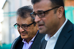 © Licensed to London News Pictures. 09/10/2015. London, UK. Anni Dewani's father Vinod Hindocha (left) and uncle Ashock Hindocha (right) giving a statement to media outside North London Coroner's Court in Barnet, north London where a Coroner ruled there will be no inquest into murdered honeymoon bride Anni Dewani. Photo credit: Ben Cawthra/LNP