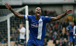 Peterborough United's Tyrone Barnett celebrates - Photo mandatory by-line: Joe Dent/JMP - Tel: Mobile: 07966 386802 12/10/2013 - SPORT - FOOTBALL - Vale Park - Stoke-on-Trent - Port Vale V Peterborough United - Sky Bet League 1