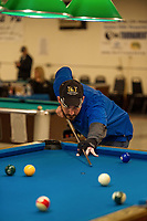 Patrick Ferland focuses in on his shot during the Robbie Mills 8-Ball Tournament at the Rod and Gun on Saturday afternoon.  (Karen Bobotas/for the Laconia Daily Sun)