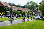 Hutton Le Hole, picturesque village on the Yorkshire moor, England, UK.<br /> Summer visitors and passing cyclists.