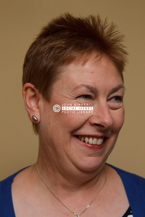 Portrait of woman smiling.  Cleared for Mental Health issues.