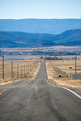 long road leading to the mountains in Las Vegas, NM