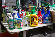 Display of various garden products in plastic spray containers outside hardware store, Woodbridge, Suffolk, England, UK