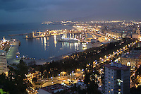 Night view of Malaga, Spain, from the parador, Malaga Gbralfaro. Port. Harbour. Ref: 200202164965.<br /> <br /> Copyright Image from Victor Patterson, Belfast, UK<br /> <br /> t: +44 28 9066 1296 (from Rep of Ireland 048 9066 1296)<br /> m: +44 7802 353836<br /> <br /> victorpattersonbelfast@gmail.com<br /> www.images4media.com<br /> <br /> Please see my Terms and Conditions of Use at https://www.images4media.com/p/terms-conditions  It is IMPORTANT that you familiarise yourself with them.<br /> <br /> Images used on the Internet incur an additional cost and must be visibly watermarked i.e. © Victor Patterson within the body of the image and copyright metadata must not be deleted. Images used on the Internet have a size restriction of 4 kbs and are chargeable at rates available at victorpatterson.com.<br /> <br /> This image is only available for the use of the download recipient i.e. television station, newspaper, magazine, book publisher, etc, and must not be passed on to any third party. It is also downloaded on condition that each and every usage is notified within 7 days to victorpattersonbelfast@gmail.com<br /> <br /> The right of Victor Patterson to be identified as the author is asserted in accordance with The Copyright Designs And Patents Act (1988). All moral rights are asserted.