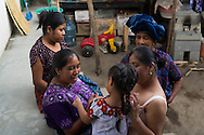 Members of the Perez family gather outside of their home in Santa Catarina, Guatemala.