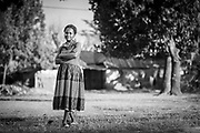 Portrait of mid adult woman trained as seamstress and Community Health Worker, Uganda
