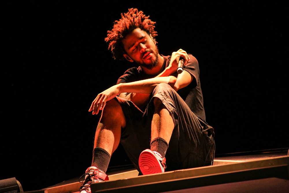 J. Cole performing at the Hollywood Casino Amphitheatre in Tinley Park, IL on July 28, 2015.