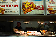Adda Martinez, an employee for 12 years, prepares chili cheese fries in the kitchen during the last weekend of service at Wienerschnitzel in Milpitas, California, on February 22, 2014.  The S. Park Victoria Dr. location is closing its doors after 17 years of service after the the stores lease was not renewed. (Stan Olszewski/SOSKIphoto)