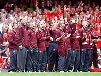 Photo: Daniel Hambury.<br />Arsenal v Wigan Athletic. The Barclays Premiership. 07/05/2006.<br />Arsenal's players celebrate as the fireworks go off.