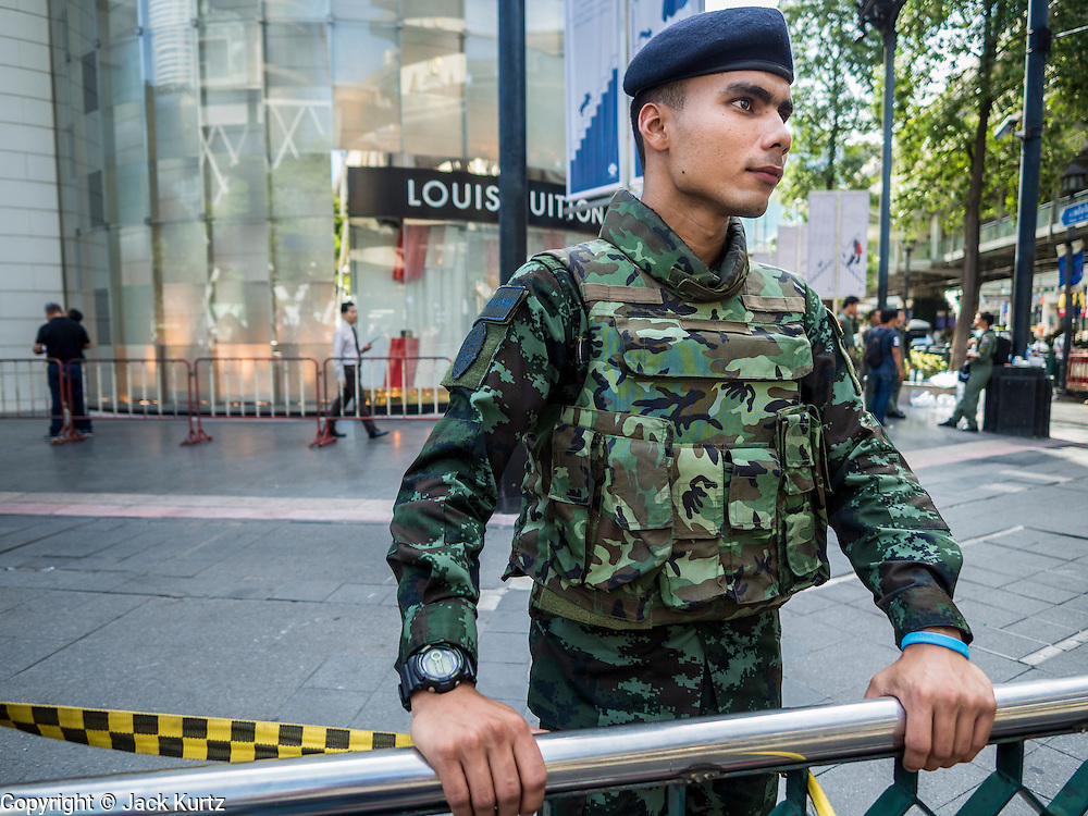 18 AUGUST 2015 - BANGKOK, THAILAND: A Thai soldier guards the Louis Vuitton store in Gaysorn, an exclusive mall across the street from Erawan Shrine. The windows to the store was broken in the bombing at the shrine. An explosion at Erawan Shrine, a popular tourist attraction and important religious shrine in the heart of the Bangkok shopping district, killed at least 20 people and injured more than 120 others, including foreign tourists, during the Monday evening rush hour. Twelve of the dead were killed at the scene. Thai police said an Improvised Explosive Device (IED) was detonated at 18.55. Police said the bomb was made of more than six pounds of explosives stuffed in a pipe and wrapped with white cloth. Its destructive radius was estimated at 100 meters.    PHOTO BY JACK KURTZ